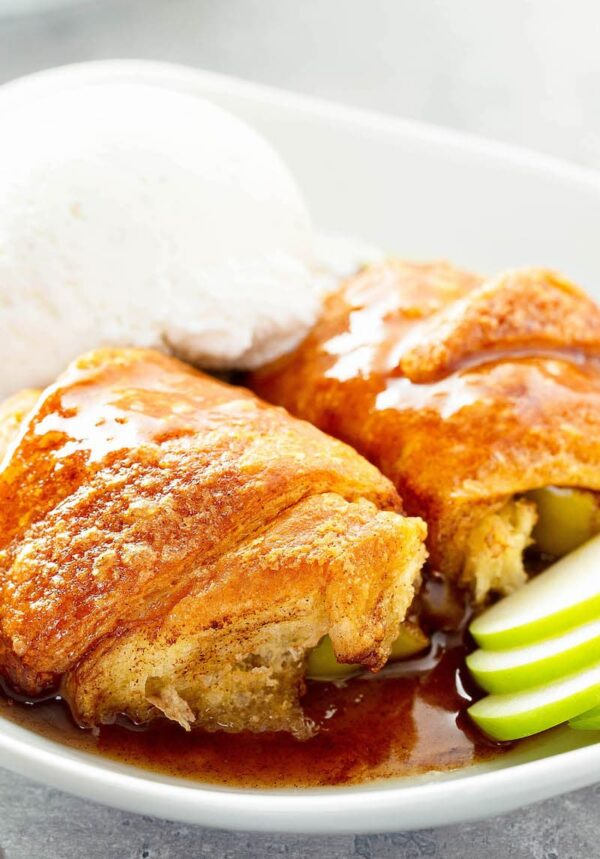Apple Dumplings in a bowl with vanilla ice cream.