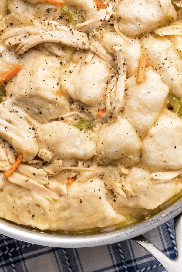 Up close image of easy chicken and dumplings in a skillet.