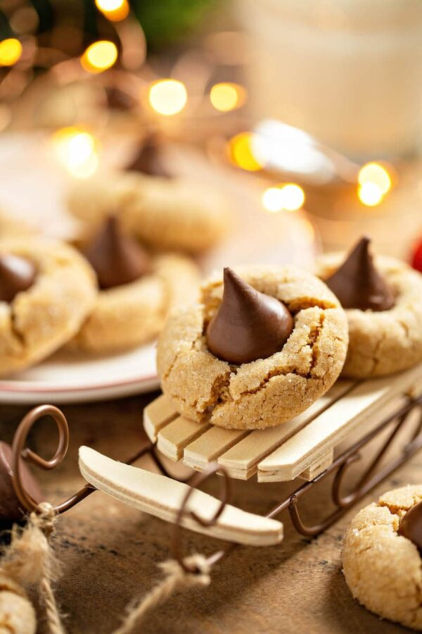 Peanut Butter Blossoms riding a sleigh ornament.