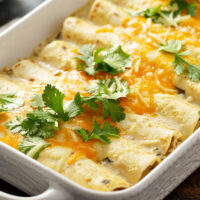 Close up of a tray with chicken enchiladas