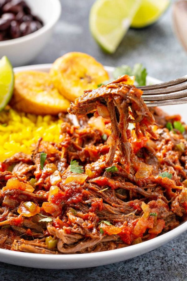 Taking a bite of ropa vieja.