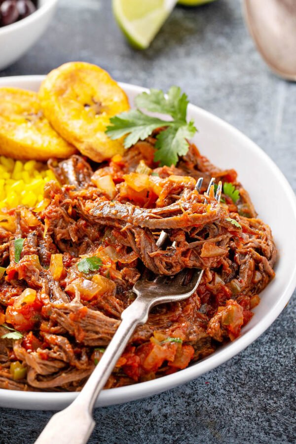 A fork picking up ropa vieja.