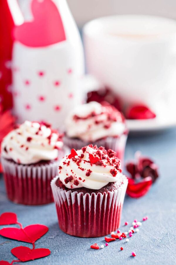 Photo of red velvet cupcakes with heart decorations