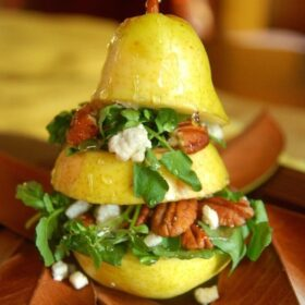 a pear sliced in thirds stuffed with salad