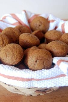 Gingerbread muffins in a bowl with a tea towel.