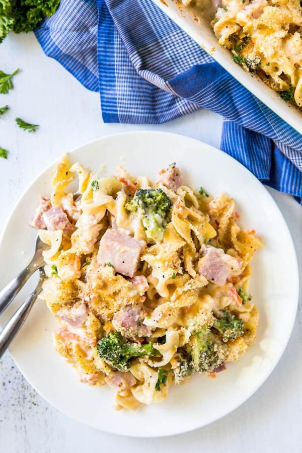 Creamy Ham Casserole on a white plate with forks.