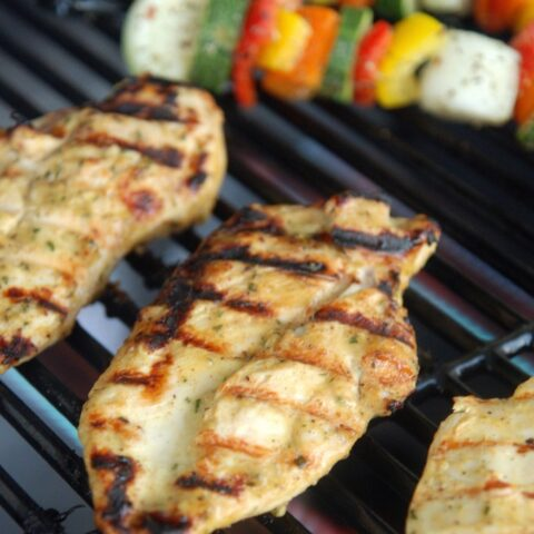 Grilled chicken breasts on a grill