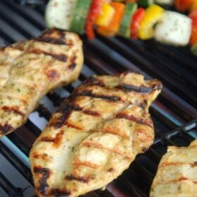Close up of grilled chicken on a grill