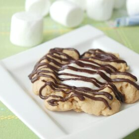 Large fluffernutter cookie on a white plate on a placemat.
