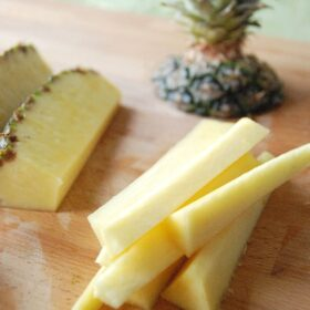 Pineapple with the top cut off cut into slices.