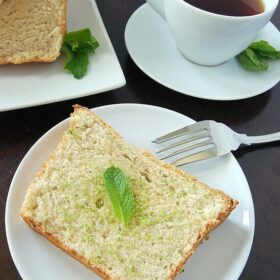 Almond pound cake on a plate with a cup of coffee