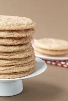 Chai snickerdoodle cookies stacked on a cake stand.