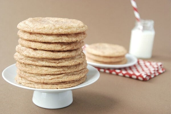 A Stack of Chai Snickerdoodles on a Cake Stand with More Cookies on a Plate in the Background