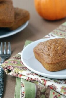 Pumpkin snack cakes on decorative napkin with fork and pumpkin in background