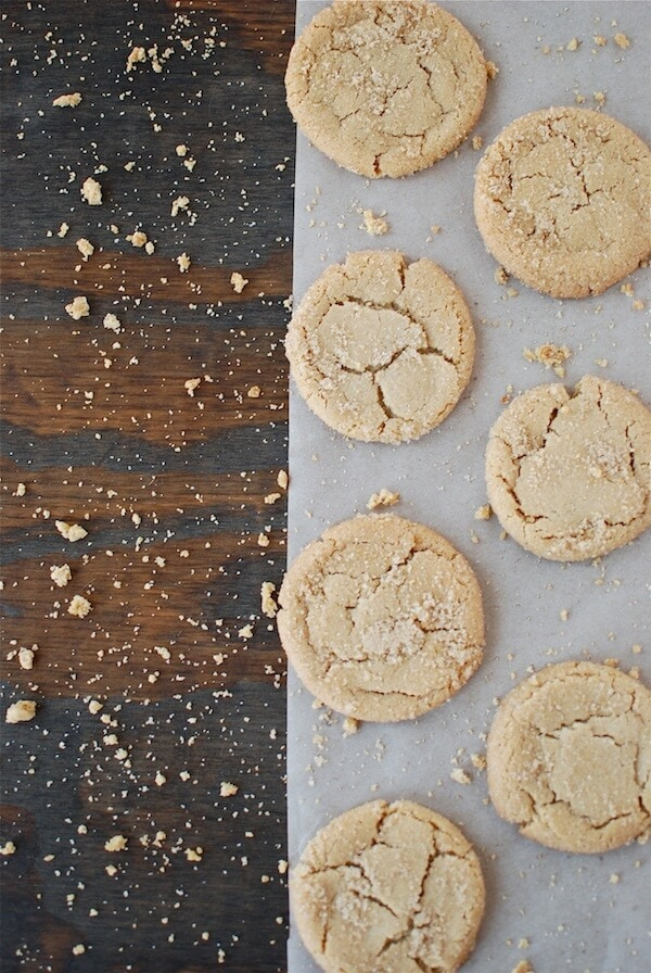 7 brown butter sugar cookies on a piece of parchment paper.