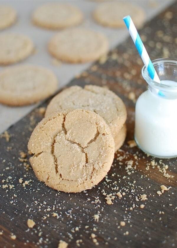 Brown butter sugar cookies set near a glass of milk.