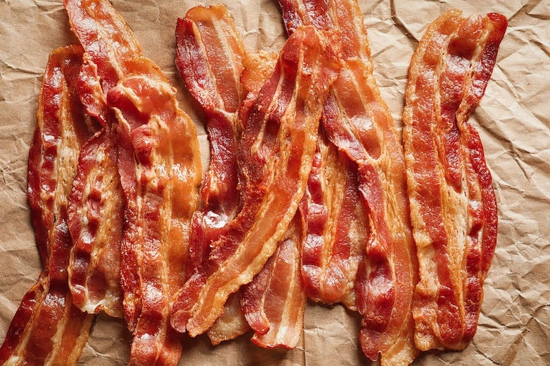 Crispy baked bacon on parchment paper