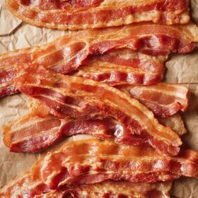 crispy bacon cooked in the oven on parchment paper