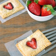Baked pie crust pastry with fresh strawberries on top.