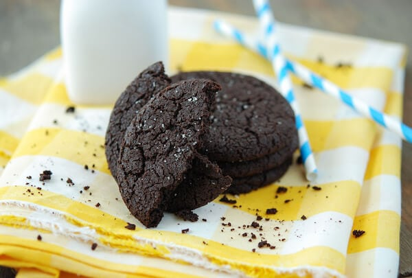 Four Rich Homemade Chocolate Cookies on Top of a Plaid Dish Towel