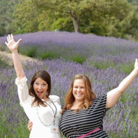 Two girls standing in front of lavender fields