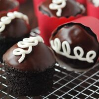 Homemade Hostess Cupcakes in red wrapper on a cooling wrack