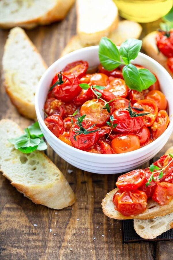 Garlic Roasted Cherry Tomatoes on toast with fresh basil.