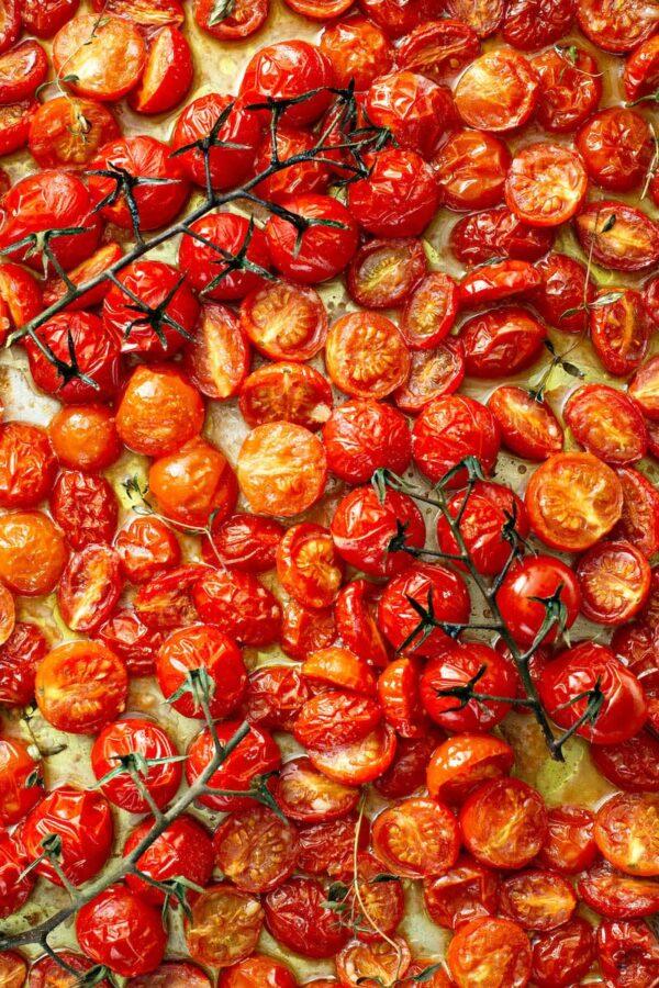 Garlic Roasted Tomatoes on a sheet pan.