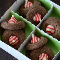 These candy cake cookies are filled with chocolate and topped with Hershey's candy cane kisses.
