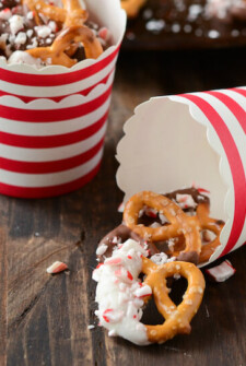 Small red and white cups with Peppermint & Chocolate Pretzels
