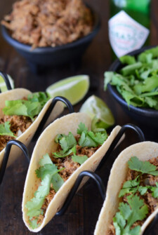 Pork carnitas in soft tacos shells topped with cilantro