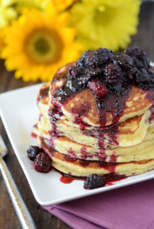 Stack of Sweet Hoecakes with Blackberry Rum Sauce on a white plate