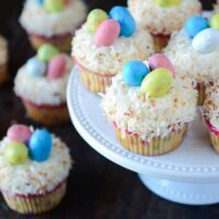 Coconut Cupcakes topped with Robin's Eggs on a white cake plate