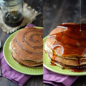 Banana Cinnamon Swirl Pancakes on a green plate with a fork and a drizzle of syrup.
