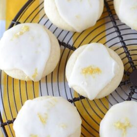 A Cooling Rack Full of Lemon Shortbread Cookies with Lemon Frosting