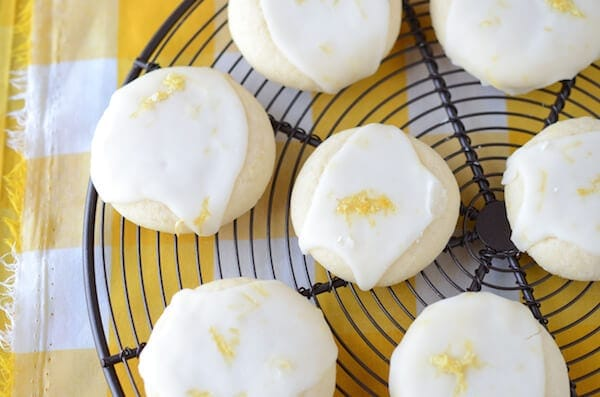 Lemon Meltway Cookies: a super soft lemon shortbread style cookie topped with royal icing and lemon zest!