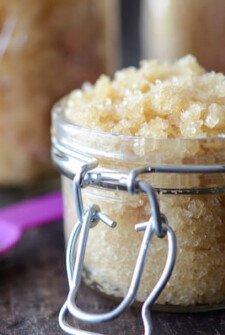DIY Coconut Sugar Scrub in small glass jar with a purple spoon