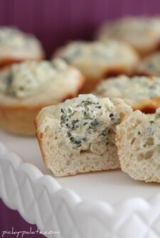 Half of a Baked Spinach Dip Mini Breadroll Stuffed with Cheese & Spinach