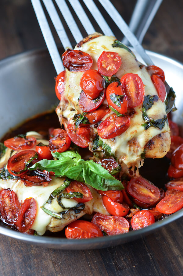 CAPRESE CHICKEN: the original perfect one pan, 30 minute, LOW CARB healthy weeknight dinner! Warm sautéed garlic tomatoes with basil, fresh mozzarella and balsamic vinegar!