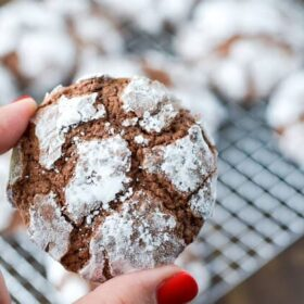 Woman showing Chocolate Crinkle Cookies.