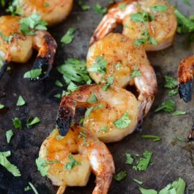Sheet pan of Sweet & Sticky Shrimp skewers