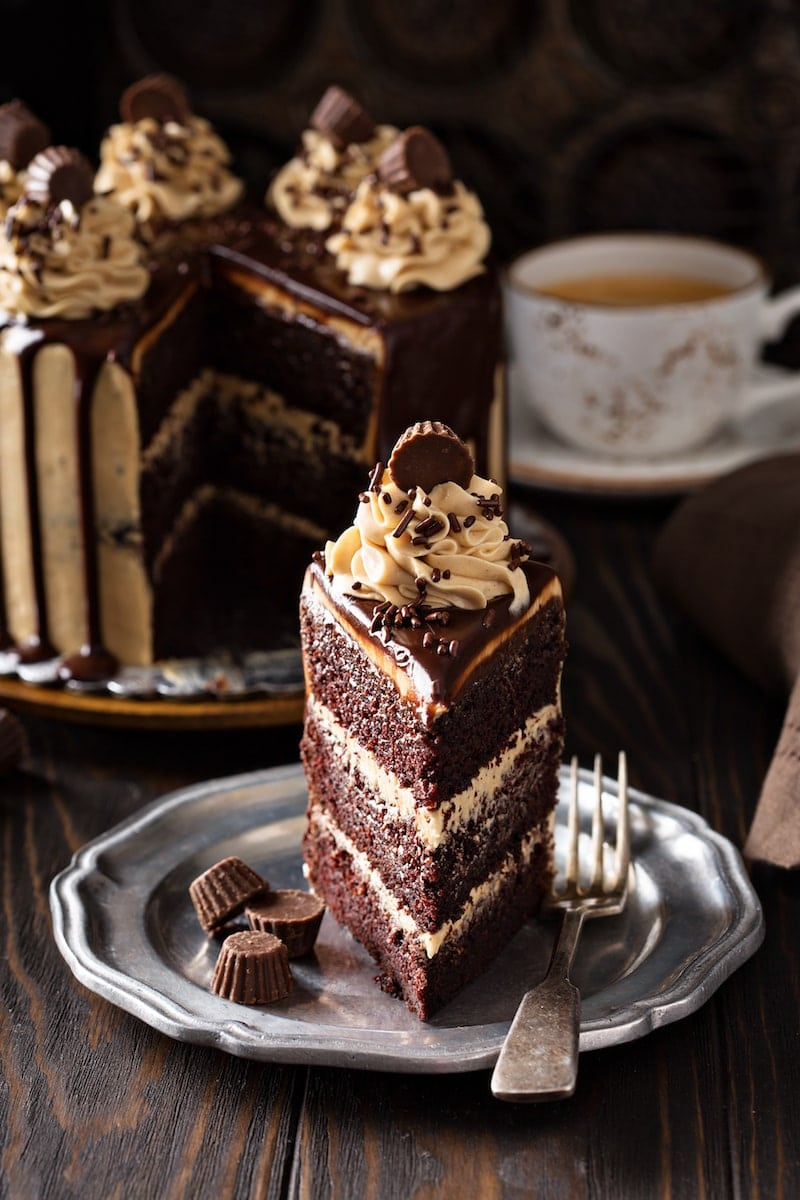Slice of Chocolate Peanut Butter Cake on a plate.