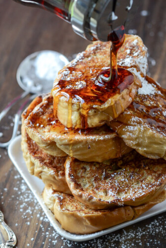 Maple Syrup Being Drizzled Over a Stack of Cuban Bread French Toast