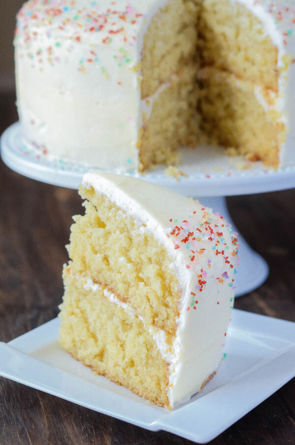 Vanilla Dream Cake: a crazy moist vanilla layer cake frosted with creamy vanilla buttercream icing combines to create the ultimate homemade vanilla cake recipe. #cake #vanilla #dessert