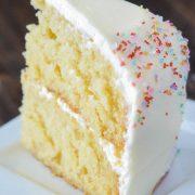 Vanilla Dream Cake: a crazy moist vanilla layer cake frosted with creamy vanilla buttercream icing combines to create the ultimate homemade vanilla cake recipe. #cake #vanilla #dessert