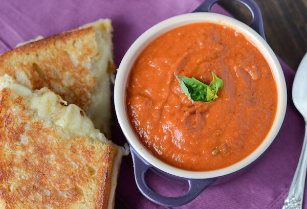 Panera Creamy Tomato Soup Copycat Recipe - Perfect easy tomato soup recipe that is crazy similar to your favorite bowl of soup at Panera!