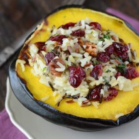 Stuffed Acorn Squash on a white plate with a fork.