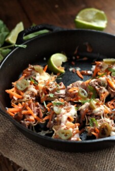 Spicy Thai Beef Nachos in a black cast iron skillet