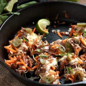Spicy Thai Beef Nachos in a black cast iron skillet