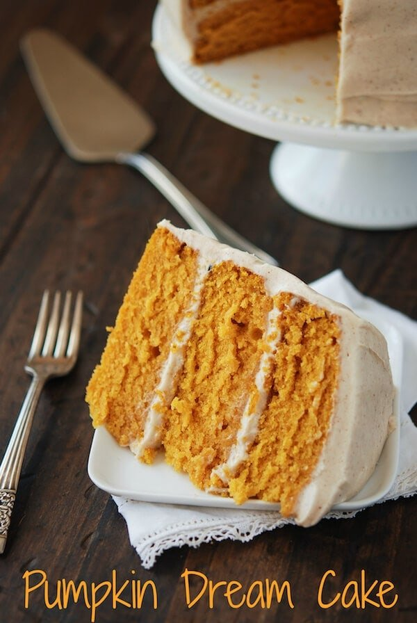 A Slice of Pumpkin Dream Cake on a Small White Plate with a Fork